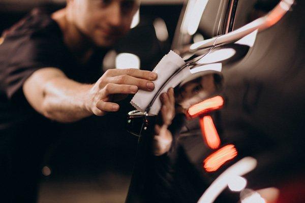 Hand polishing black car door