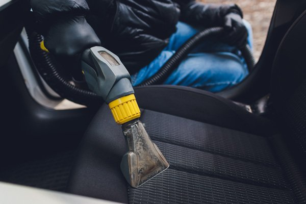 Steam cleaning upholstery car seat