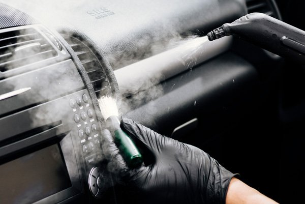 Steam brushing car dashboard