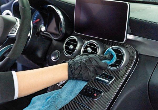 luxury car screen being cleaned
