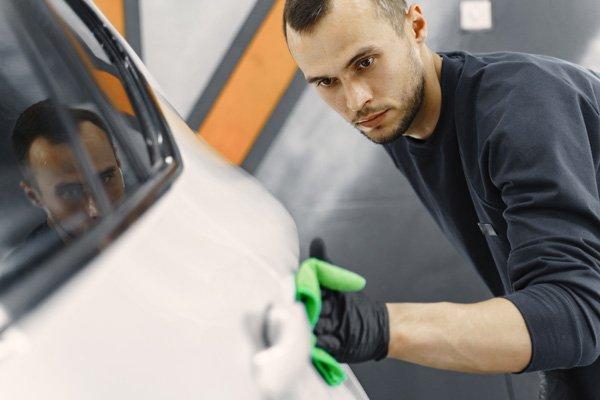 white car getting detailed polish